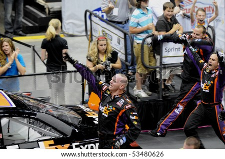 CHARLOTTE, NC - MAY 19:  The number 11 pit crew for Denny Hamlin's FedEx car beging celebrating as they cross the line to win the 2010 NASCAR Pit Crew Challenge MAY 19 2010 in CHARLOTTE, NC