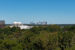 Charlotte, North Carolina city skyline in early autumn with blue skies