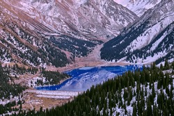 Charming autumn scene of Big Almaty lake at twilight; magnificent mountain lake in the last light of the passing day
