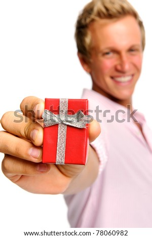 Charming blond man holds a red ring box to propose