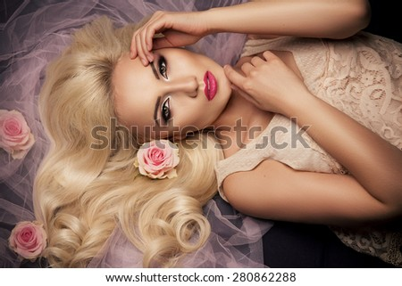 Charming blonde girl with a flowers.  Woman with beautiful face.