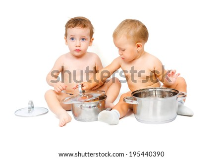 Charming boy and a girl in the role of chef play with pot isolated on white background
