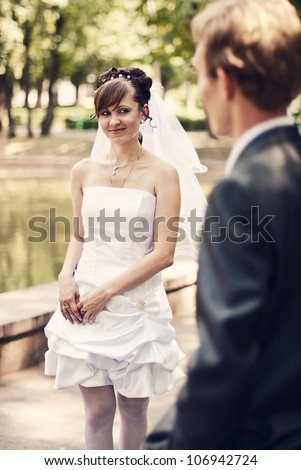 stock photo charming bride and groom in a sunny park soft focus groom 106942724
