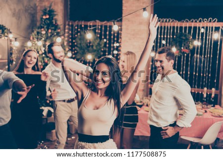 Charming caucasian brunette elegant charming lady with raised up hands, in beige wear, group of festive youth on fancy feast, many, classy outfits, all night, indoors event #1177508875