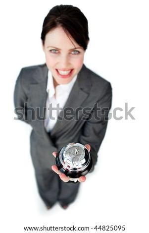 Charming caucasian businesswoman showing a service bell against a white background