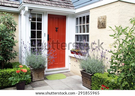 Charming colorful front door entrance with blooming lavender in containers.  #291855965