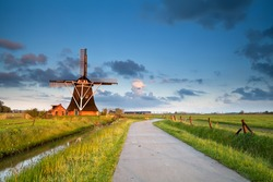 charming Dutch windmill in morning sunshine, Groningen, Holland