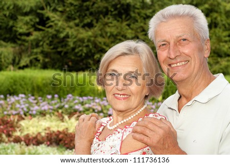 Charming elderly couple went for a walk in the park