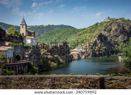 Charming French village on Tarn River with church and tunnel #340759892