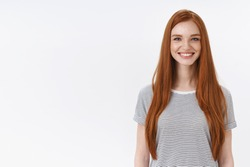 Charming friendly pleasant redhead girl university student smiling happily camera look energized participate dance class learning new hobby standing white background entertained, lifestyle concept