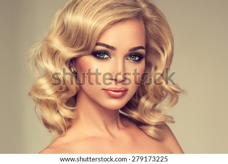Charming girl blonde curly hair . Beautiful fashion model.