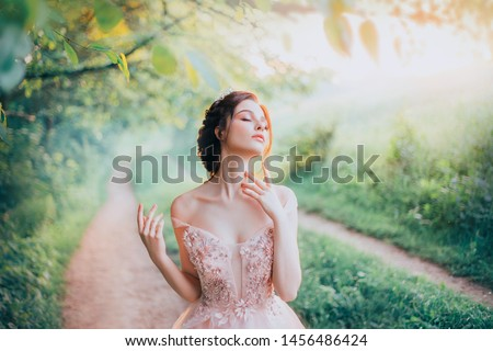 charming goddess. spring forest. stands on path enjoys natural cosmetic, lady with her eyes closed strokes beautiful neck with fingers. Fantasy art portrait. nude delicate, gentle makeup. Light haze