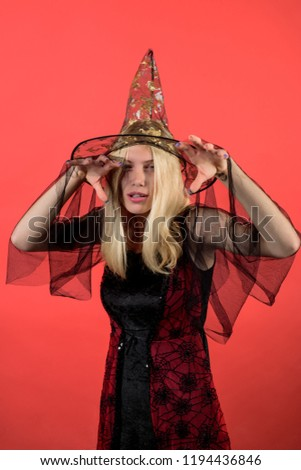 Charming halloween witch. Halloween witch creates magic. Sexy girl in witches hat&costume. 31 october. Attractive woman in magician costume celebrate Halloween. Pretty woman dressed as fairy or witch. #1194436846