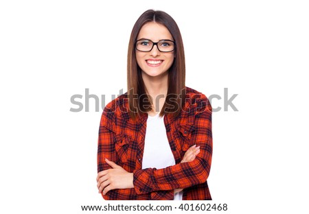 Charming handsome. Handsome young women in casual wear keeping arms crossed and smiling while standing isolated on white background