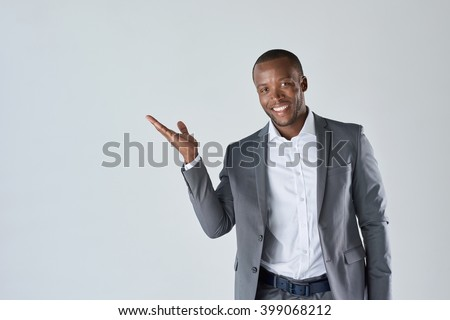 Charming handsome young black business man holding his hand up to show present sell product #399068212