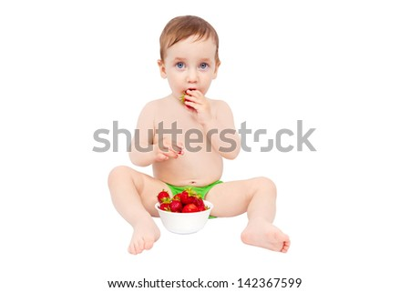 Charming kid eats ripe strawberries isolated on white background