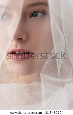 Charming lady in beautiful veil looking away and keeping lips slightly parted Stockfoto ©