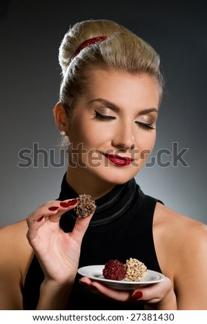Charming lady tasting chocolate