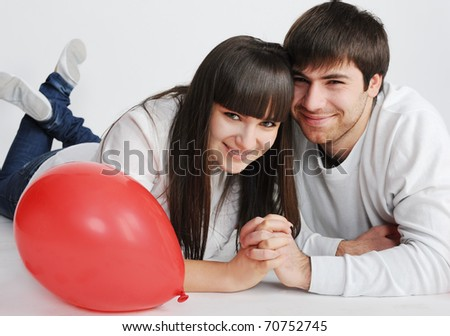 Charming love couple lying on the floor