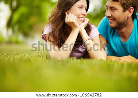 Charming lovers spending time in he open air enjoying the company of each other