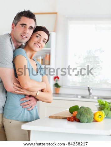 Charming Man and woman hugging in a kitchen