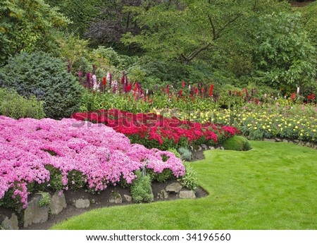 Charming multi-colour flower bed  in well-known Butchard-garden in Canada