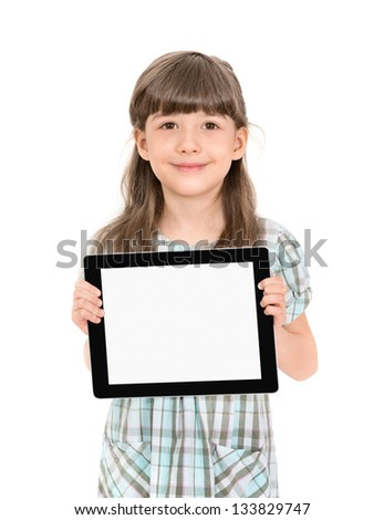 Charming pretty little girl holding up a modern digital tablet in her hands with the blank white screen. Isolated on white.