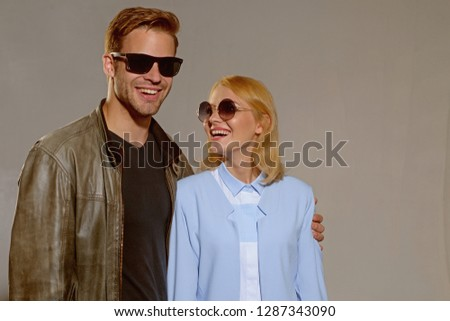 Charming relationship. Fashion models in trendy sun glasses. Couple in love. Couple of man and woman wear fashion glasses. Love relations. Friendship day. Friendship relations. Lust and romance. #1287343090