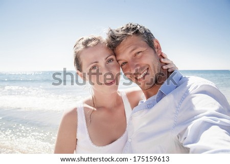 charming smiling couple with selfportrait