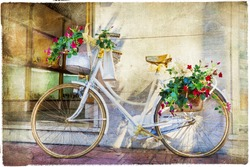 charming street  with old bike and flowers, artistic vintage picture