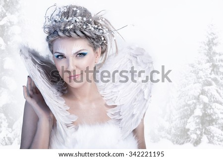 Stock Photo Charming winter queen, posing over winter background