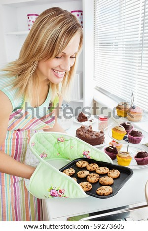 Charming woman baking in the kitchen at home