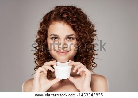 Charming woman naked shoulders curls beauty salon charm spa treatments