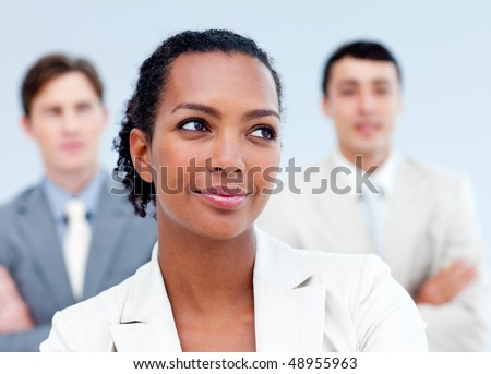 Charming young business people standing with folded arms
