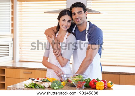 Charming young couple posing in their kitchen