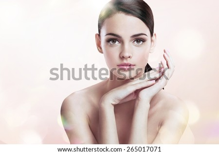 Charming young female with perfect makeup, skin care concept / photoset of attractive brunette girl on blurred beige background with bokeh