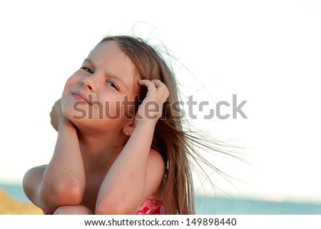 Charming young girl in a pink bathing suit sitting on a background of the sea girl on the black - Charming teenage girls image ...