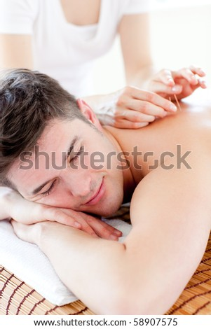 Charming young man in an acupuncture therapy
