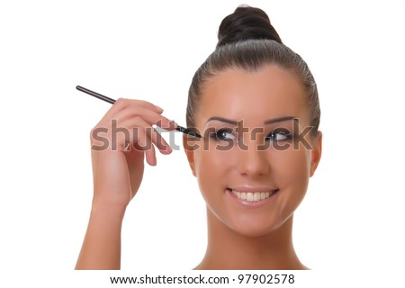 Charming young woman applying blusher eyelid close up , on white  background.