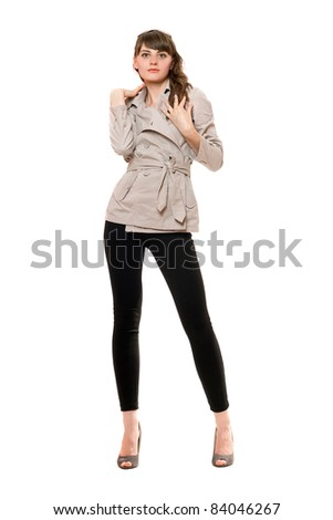 Charming young woman wearing a coat and black leggings