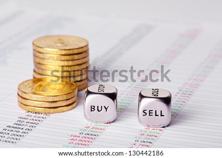 Chart, coins and dices cubes with words Sell Buy. Selective focus