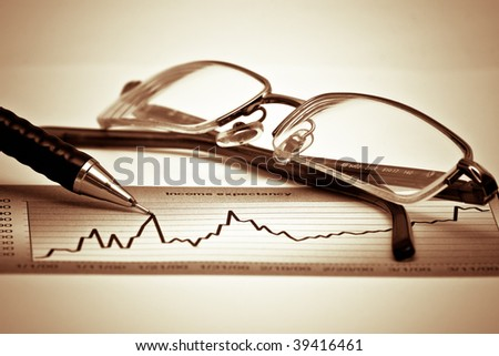 Chart, glasses and pen - stock photo