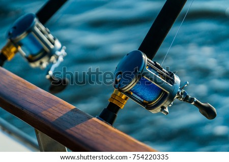 Charter deep sea fishing gear at sunset