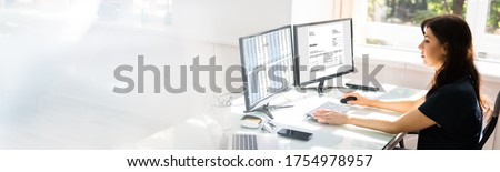 Chartered Professional Accountant Working With Invoice On Computer