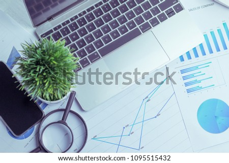 Charts and graphs are placed on the desks, data, and statistical performance of the company in the past year. #1095515432