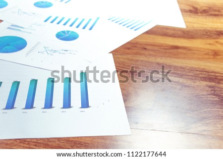 Charts and graphs are placed on the desks, data, and statistical performance of the company in the past year. #1122177644