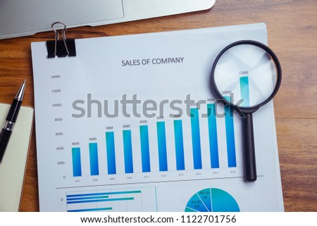 Charts and graphs are placed on the desks, data, and statistical performance of the company in the past year. #1122701756