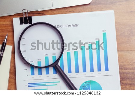 Charts and graphs are placed on the desks, data, and statistical performance of the company in the past year. #1125848132