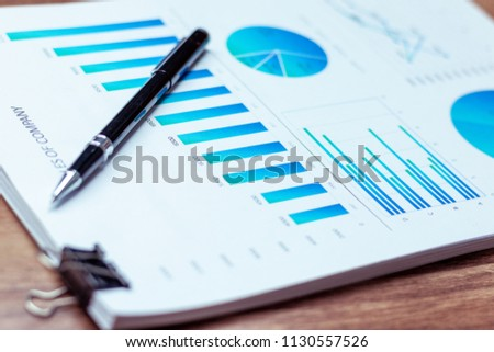 Charts and graphs are placed on the desks, data, and statistical performance of the company in the past year. #1130557526