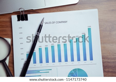 Charts and graphs are placed on the desks, data, and statistical performance of the company in the past year. #1147173740